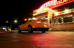 2007 Ford Shelby GT500 in front of a fast food restaurant with neon lights in Woodward avenue, Detroit, Michigan, USA