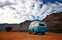 VW Transporter T2 parked beside the road with mountains in the background. Red Valley, Nevada
