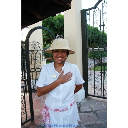 Smiling hostess in front of the entrance door of the Hotel Casa Velas. Puerto Vallarta, Jalisco, México