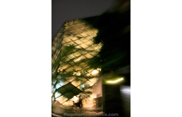 Prada building photographed from a car passing by at low shutter speed, at night. Tokyo, Japan