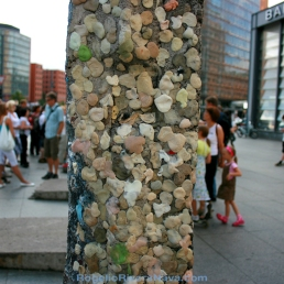 Chewing gum wall surrounded by crowds of tourists. Postdamer Platz, Berlin