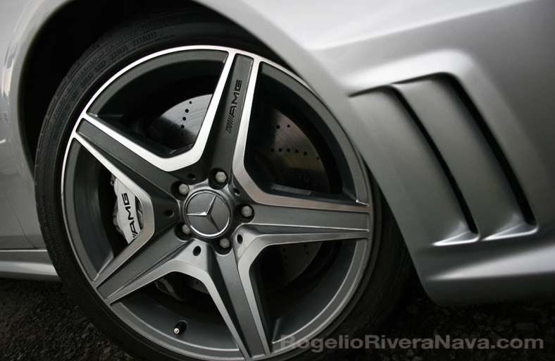 2008 Mercedes-Benz C63 AMG wheel and air scoop front fascia close up detail  [ Focal lenght: 18 | Shutter speed: 1/60 | f number: 3.5 ]