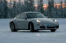 Porsche Camp4, winter driving school, 997 Porsche 911 Carrera 4S drifting in circle shaped iced track, Rovaniemi, Finland