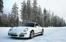 Porsche Camp4, winter driving school, 997 Porsche 911 Carrera 4S in iced road in woods, Rovaniemi, Finland