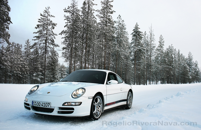 Porsche Camp4, winter driving school, 997 Porsche 911 Carrera 4S in iced road in woods, Rovaniemi, Finland  [ Focal lenght: 22 | Shutter speed: 1/80 | f number: 5.6 | ISO: 200 ]