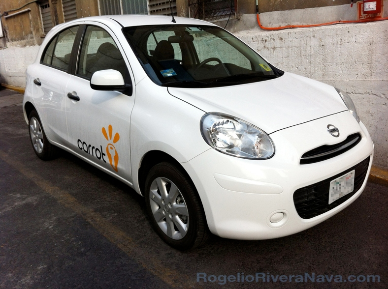Autos Compartidos de México, S.A.P.I. de C.V. Carrot, car sharing company during start-up in Mexico City. Nissan March / Micra rental unit. Photo by Rogelio Rivera-Nava / www.rogelioriveranava.com / Smartphone shot / [ Focal length: 3.85 mm (fixed) | Shutter speed: 1/559 second | f number: 2.8 ]