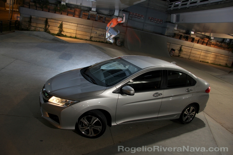 2014 Honda City for Mexican market / Three quarter front bird view with rollerskater jumping / Guadalajara city, Jalisco, Mexico / Photo by: Rogelio Rivera-Nava with the assistance of Oscar Delgado and Elias C. Gonzalez/ rogelioriveranava-com / [ Focal lenght: 17 | Shutter speed: 0.8 | f number: 7.1 | fill flash]